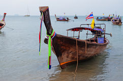 Traditional longtail boats on the Ao Nang beach at morning Royalty Free Stock Image