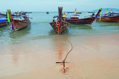 Traditional longtail boats on the Ao Nang beach at morning Stock Photography