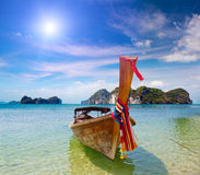 Longtail boat on a tropical island Stock Images