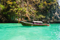 Traditional longtail boats in the famous Maya bay of Phi-phi Leh Royalty Free Stock Images