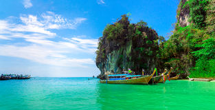 Traditional longtail boats near tropical island Royalty Free Stock Photo