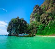 Traditional longtail boats near tropical island Stock Image