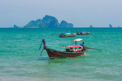 Traditional longtail boats for transport on beach, Krabi province, Thailand.  Royalty Free Stock Photos
