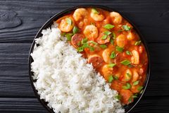 Traditional Louisiana gumbo with shrimp, sausage and rice macro. On a plate on the table. Horizontal top view from above royalty free stock photos