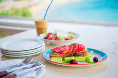 Traditional lunch with delicious fresh greek salad, frappe and brusketa served for lunch at outdoor cafe Stock Photos