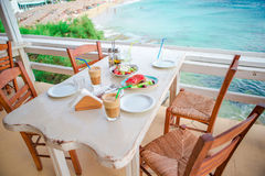 Traditional lunch with delicious fresh greek salad, frappe and brusketa served for lunch at outdoor cafe Stock Image