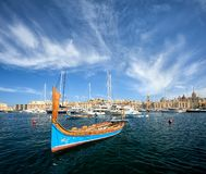 Traditional luzzu in Birgu harbour, Malta royalty free stock photography