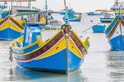 Traditional Luzzu boat at Marsaxlokk harbor in Malta. Traditional Luzzu boat at Marsaxlokk harbor, a fishing village located in the south-eastern part of Malta Royalty Free Stock Images