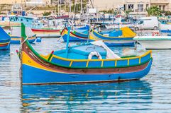 Traditional Luzzu boat at Marsaxlokk harbor in Malta stock photo