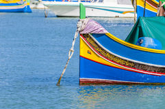 Traditional Luzzu boat at Marsaxlokk harbor in Malta. Traditional Luzzu boat at Marsaxlokk harbor, a fishing village located in the south-eastern part of Malta Royalty Free Stock Image