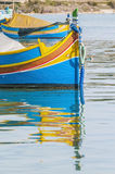 Traditional Luzzu boat at Marsaxlokk harbor in Malta. Traditional Luzzu boat at Marsaxlokk harbor, a fishing village located in the south-eastern part of Malta Stock Images