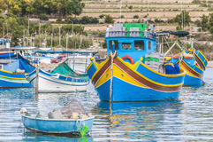 Traditional Luzzu boat at Marsaxlokk harbor in Malta. Stock Images