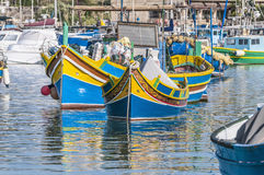 Traditional Luzzu boat at Marsaxlokk harbor in Malta. Traditional Luzzu boat at Marsaxlokk harbor, a fishing village located in the south-eastern part of Malta Royalty Free Stock Photo