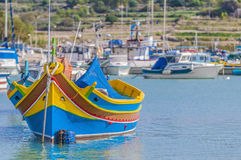 Traditional Luzzu boat at Marsaxlokk harbor in Malta. Traditional Luzzu boat at Marsaxlokk harbor, a fishing village located in the south-eastern part of Malta Royalty Free Stock Photography