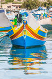 Traditional Luzzu boat at Marsaxlokk harbor in Malta. Royalty Free Stock Image