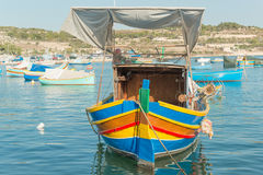 Traditional luzzu boat. At Marsaxlokk village, Malta Royalty Free Stock Photo