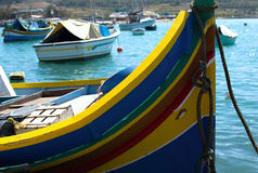 Traditional luzzu boats in Marsaxlokk. Traditional colourful fishing boats in Marsaxlokk, Malta Royalty Free Stock Photo