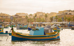 Traditional Luzzu fishing boats at Marsaxlokk Market at morning - Malta. Traditional Luzzu fishing boats at Marsaxlokk Market at morning Royalty Free Stock Images
