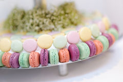 Traditional macarons on a glass cake stand Stock Photo
