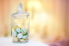 Traditional macarons in a glass jar Stock Photo