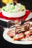 Traditional Macedonian food - krvavica sausage with shopska salad. Shallow dof stock photo