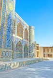 The traditional majolica. The Nadir Divan-Beghi madrasah is decorated with majolica in ancient traditional style, Bukhara, Uzbekistan Stock Photos