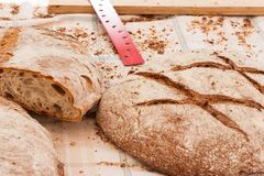 Traditional Majorcan brown bread pan moreno on the table covered with tablecloth. Sineu market, Majorca Stock Photos