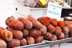 Traditional Majorcan Sobrassada sausage Sobrasada de Mallorca for sale in the stall of Sineu market Stock Photo