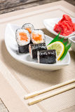 Traditional Maki sushi served with wasabi and ginger Royalty Free Stock Photo