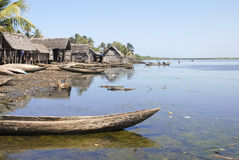Traditional malagasy boat - canoe on african beach Stock Images