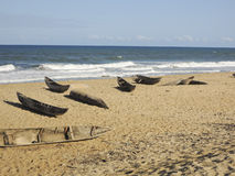 Traditional malagasy boat - canoe on african beach Royalty Free Stock Photo