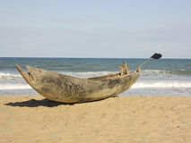 Traditional malagasy boat - canoe on african beach Royalty Free Stock Photos