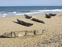 Traditional malagasy boat - canoe on african beach Royalty Free Stock Photography