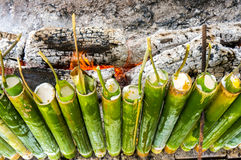 Traditional Malay food,. A row of traditional Malay food, lemang. Lemang is made of glutinous rice and cook in a bamboo sticks during eid celebration in Malaysia Royalty Free Stock Images