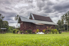 Traditional Malay House in Malaysia. A traditional Malay village housein Malaysia, The main characteristic of a typical Malay kampung house is built on stilts or royalty free stock photography