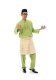 Traditional malay male. With raya cookie Stock Photos