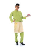 Traditional malay male. With raya cookie Stock Photography