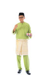 Traditional malay male. With raya cookie Royalty Free Stock Photo