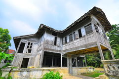 Traditional malay wooden house. This is a malay traditional house, made from wood, sometimes equipped with concrete stairs. its very cozy to stay in this kind of Royalty Free Stock Photo