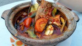 Traditional Malaysia Fish dish called Asam Pedas Royalty Free Stock Photo