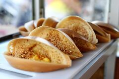 Free Traditional Malaysian Street Food Apam Balik - Thick Soft Pancake With Peanuts, Bananas, Peanut Butter And Sweet Corn. Royalty Free Stock Images - 182752399