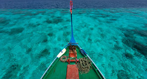 Traditional maldivian boat dhoni. Close up of a traditional maldivian boat dhoni in a tropical ocean Stock Photo