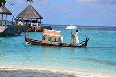 Maldivian Dhoni. Traditional Maldivian Dhoni boat in use at Four Seasons Resort Maldives Stock Photos