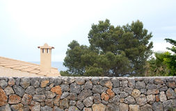 Traditional Mallorquin drystone wall and roof top Royalty Free Stock Photos