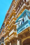 Traditional Maltese balconies, Valletta. Maltese balconies are important part of local architecture, typical for edifices in every city, town and village of Royalty Free Stock Image