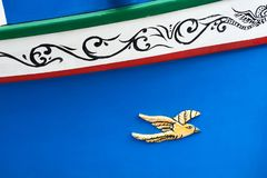 Traditional maltese boat luzzu detail. Abstract close up view of the Maltese wooden fishing boat called Luzzu with traditional decoration and vibrant painting royalty free stock image