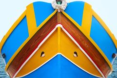 Traditional maltese boat luzzu detail. Abstract close up view of the Maltese wooden fishing boat called Luzzu with traditional decoration and vibrant painting stock photography