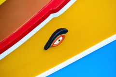 Traditional maltese boat luzzu detail. Abstract close up view of the Maltese wooden fishing boat called Luzzu with traditional decoration and vibrant painting stock photos