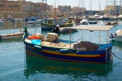 The traditional Maltese boat Luzzu moored in the Kalkara creek. The traditional Maltese fishing boat Luzzu moored in the Kalkara creek between Kalkara and Birgu Royalty Free Stock Photo