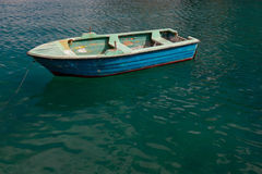 Traditional Maltese Boat. In a popular and quaint harbor village in Malta Royalty Free Stock Image